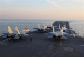 This picture, taken in December 2016, shows Chinese J-15 fighter jets waiting on the deck of the Liaoning aircraft carrier during military drills in the Bohai Sea, off China's northeast coast.