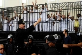 This photo, dated May 19, 2014, shows a mass trial of political prisoners as defendants in the cage receive sentences ranging from death by hanging, life in jail and eight to 15 years in prison on charges of murder, rioting, and violence, in Alexandria, Egypt.