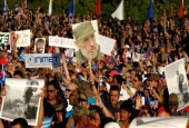 Cuban people participate in a military parade in honor of recently deceased Cuban leader Fidel Castro at Havana