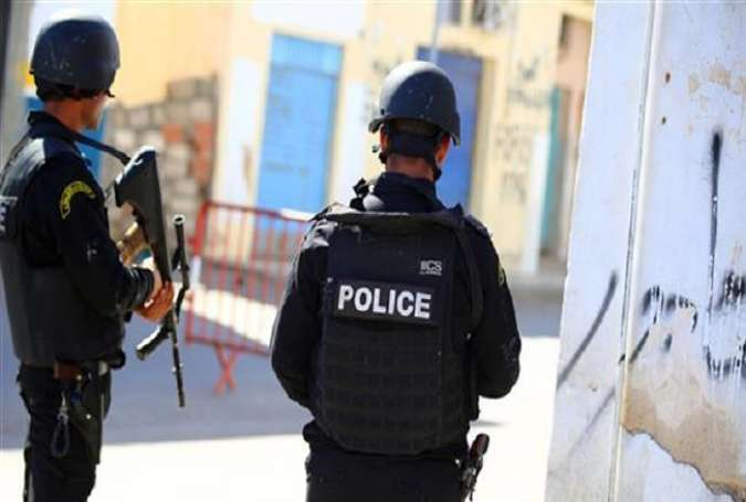 Tunisian police officers are seen on the outskirts of Ben Guerdane, southern Tunisia, March 8, 2016.