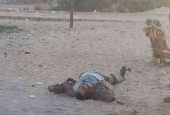 This photo, taken from the site of a militant attack on a checkpoint in the city of el-Arish, shows the body of a militant incapacitated by security forces, Egypt, January 9, 2017.