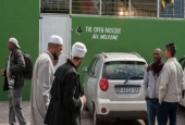 Muslim worshipers stand by at Cape Town mosque amid reports that two mosque in the city were defaced in rare Islamophobic acts in the country.