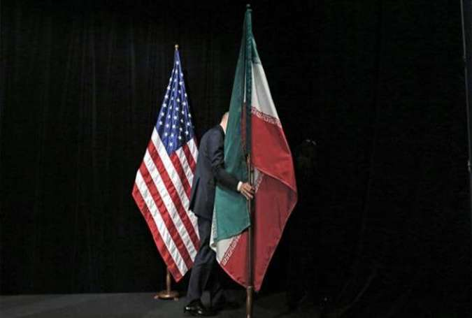 A staff member removes the Iranian flag from the stage after a group picture with foreign ministers and representatives of the Unites States, Iran, China, Russia, Britain, Germany, France, and the European Union during the Iran nuclear talks at the Vienna International Center in Vienna on July 14, 2015.