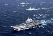 China's Liaoning aircraft carrier, with an accompanying fleet, conducts a military exercise in the South China Sea.
