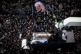 Mourners take part in the funeral of Ali Akbar Hashemi Rafsanjani. Some of the chants called for the release of former prime minister Mir Hossein Mousavi and of Mehdi Karoubi, a cleric and former speaker of parliament who lost the disputed 2009 president