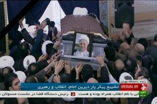 People touch the coffin of Ali Akbar Hashemi Rafsanjani during his funeral ceremony in this still image taken from video. Rafsanjani