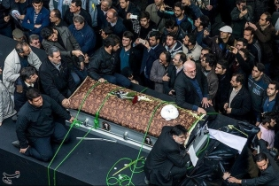 Mourners gather around the coffin of Ali Akbar Hashemi Rafsanjani during his funeral.