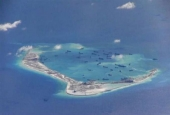 Chinese dredging vessels are purportedly seen in the waters around a reef in the disputed Spratly Islands in the South China Sea.