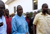 Gambian President-elect Adama Barrow (C) flanked by his supporters arrives at a hotel in the capital, Banjul, for a meeting with four African heads of state, December 13, 2016.