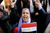 An Egyptian woman celebrates with a national flag on January 16, 2017, after a ruling against the government's islands deal with Saudi Arabia.