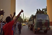People cheer Senegalese soldiers from a regional military force as they arrive at the Statehouse, in Banjul, The Gambia, on January 22, 2017.