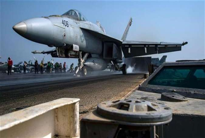 US Navy photo obtained on October 25, 2016, shows an F/A-18E Super Hornet as it launches from the flight deck of an aircraft carrier deployed in the Persian Gulf.