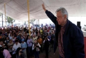 Andres Manuel Lopez Obrador, leader of the National Regeneration Movement (MORENA) party, waves after giving a speech to supporters in Tlapanaloya, Mexico, on January 25, 2017.