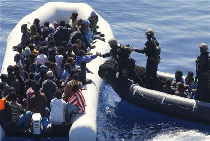 German navy sailors arrive to rescue refugees on boat off the coast of Libya in March 2016.