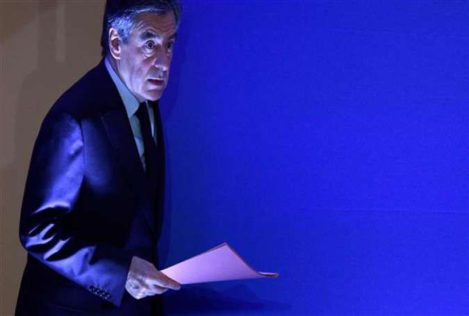 "French presidential election candidate for the right-wing Les Republicains (LR) party Francois Fillon arrives on stage to give a press conference focused on ""fake job"" allegations, on February 6, 2017 at his campaign headquarters in Paris."