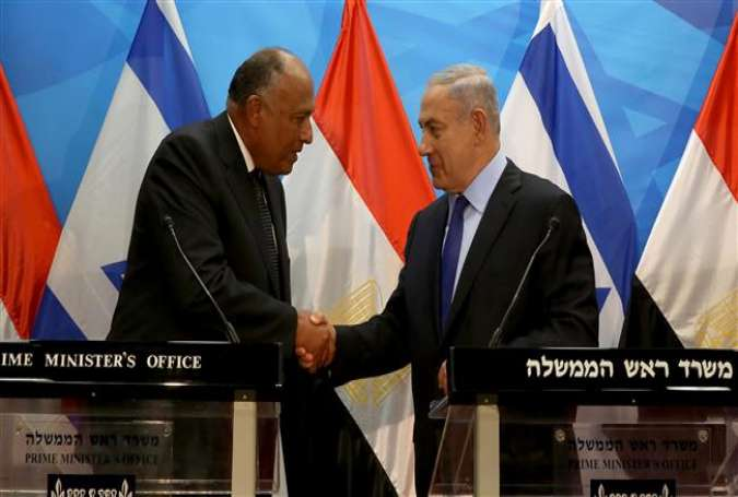Israeli Prime Minister Benjamin Netanyahu (R) shakes hands with Egyptian Foreign Minister Sameh Shoukry after giving a joint statement prior to their meeting at his Jerusalem al-Quds office, on July 10, 2016.