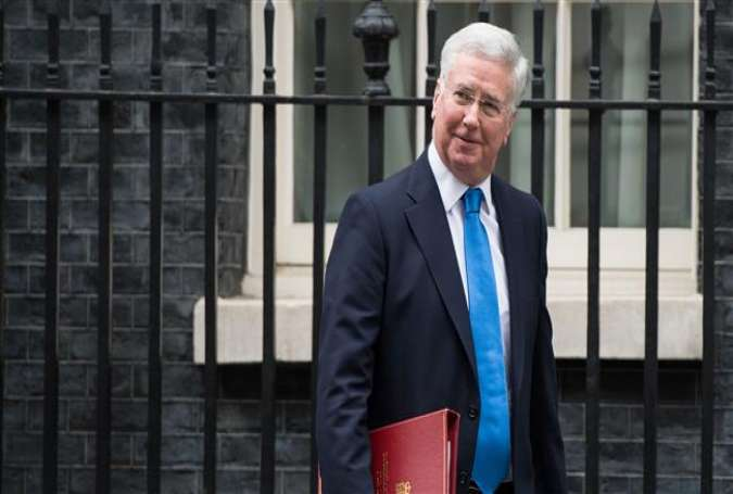 British Defense Secretary Michael Fallon leaves 10 Downing Street after a meeting of the Cabinet in central London on January 10, 2017.