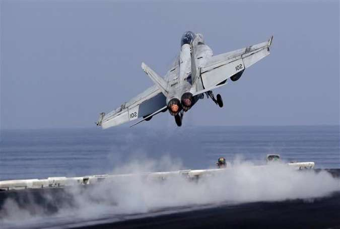 In this picture taken on November 21, 2016, a US Navy fighter jet takes off from the deck of the USS Dwight D. Eisenhower aircraft carrier in the Persian Gulf to conduct operations in Syria and Iraq.