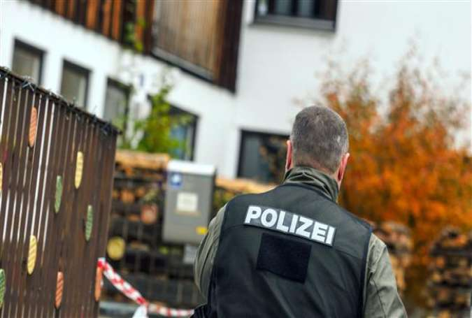 The file photo shows a German police officer during a raid in the south of the country.