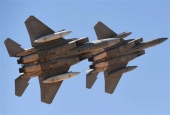 Saudi Air Force F-15SA fighter jets perform during a ceremony at King Salman airbase in Riyadh, January 25, 2017.