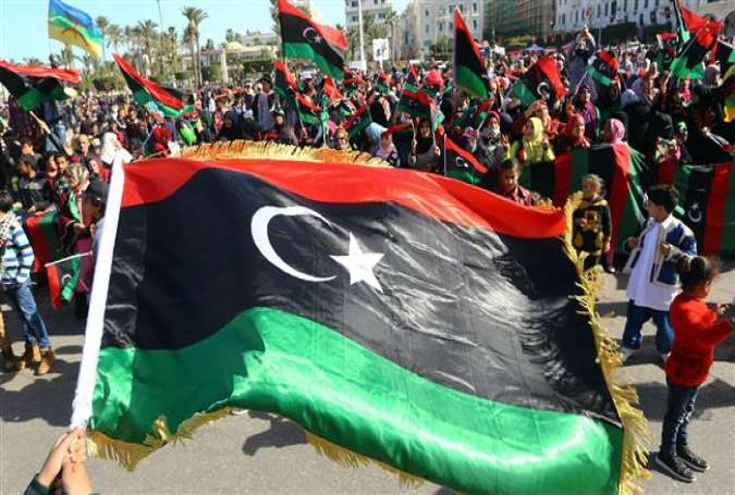 Libyans take part in a celebration marking the sixth anniversary of the Libyan revolution at the Martyrs