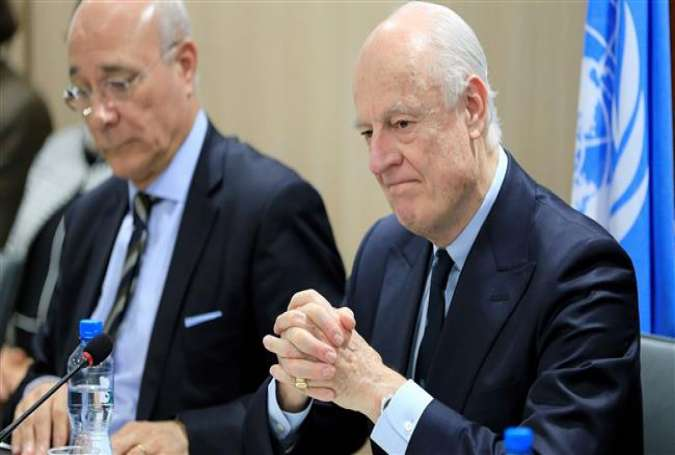 The UN special envoy for Syria, Staffan de Mistura, (R) attends Geneva peace talks between the Syrian government and the opposition on February 25, 2017