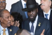 President of South Sudan Salva Kiir (R) arrives for the 28th African Union summit in Addis Ababa on January 30, 2017.