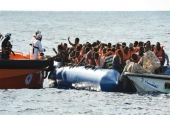 A file photo of refugees sitting on a rubber boat during a rescue operation by a Maltese NGO and the Italian Red Cross with the help of Libyan coastguards