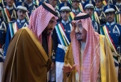 A handout picture released by the Saudi Royal Palace shows Saudi King Salman bin Abdulaziz (R) chatting with deputy Crown Prince Mohammed bin Salman during a ceremony marking the 50th anniversary of the creation of the King Faisal Air Academy at King Salman airbase in Riyadh on January 25, 2017.