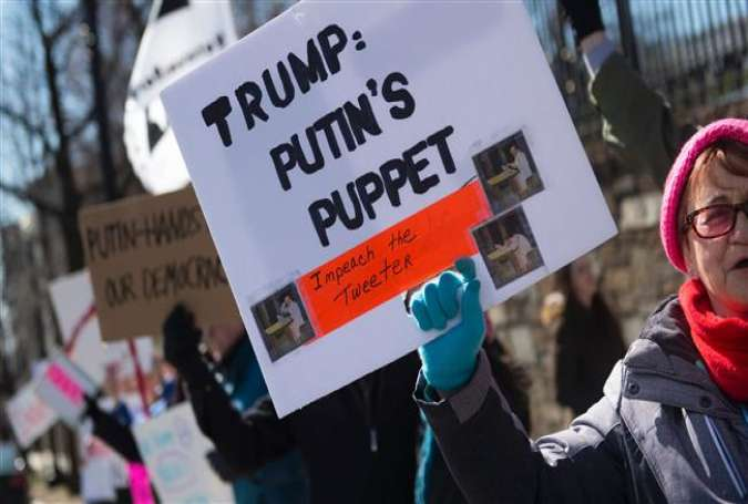 Protesters march against President Trump outside the Embassy of Russia on March 4, 2017, in Washington, DC. (Photo by AFP)