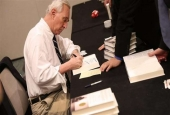 "Roger Stone, a longtime political adviser and friend to President Donald Trump, signs copies of his book ""The Making of the President 2016"" at the Boca Raton Marriott on March 21, 2017 in Boca Raton, Florida. (Photo by AFP)"