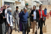 United Nations Secretary General Antonio Guterres (C) walks during a visit to the Zaatari refugee camp, which shelters some 80,000 Syrian refugees on the border with Jordan, March 28, 2017. (Photo by AFP)