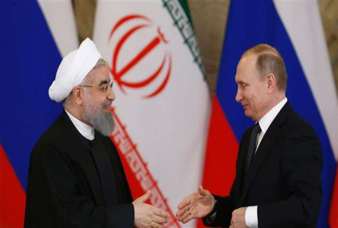 Iranian President Hassan Rouhani (L) shakes hands with Russian counterpart Vladimir Putin during their meeting at the Kremlin in Moscow on March 28, 2017. (Photo by AFP)