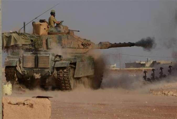 This file photo taken on October 24, 2016 shows Turkish soldiers firing an upgraded M60 tank in the near the northern Syrian village of Beraan, north of Aleppo. (Photos by AFP)