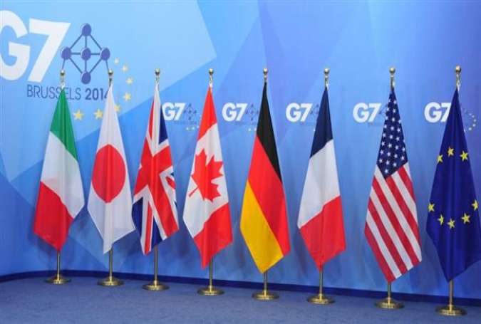 The flags of the Group of Seven countries are set on a stage for an annual summit in Brussels, Belgium (file photo)