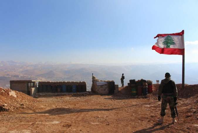 Lebanese soldiers guard an army position in the mountains above the town of Arsal