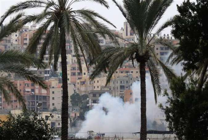 Smoke rises during clashes in Ain al-Hilweh camp, Lebanon