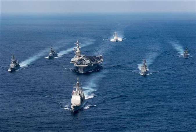 A US Navy strike group participates in a photo exercise with Japan Maritime Self-Defense Force destroyers in the Philippine Sea, March 28, 2017. (Photo via AFP)