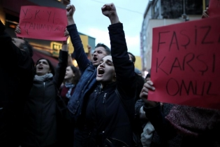 Anti-government protesters shout slogans during a demonstration at the Besiktas district in Istanbul, Turkey.