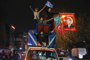 Supporters of Turkish President Tayyip Erdogan celebrate in Istanbul.