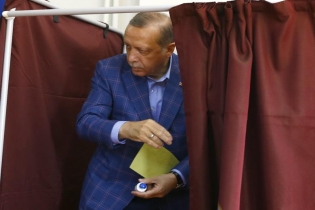 Turkish President Tayyip Erdogan leaves a voting booth at a polling station during a referendum in Istanbul.
