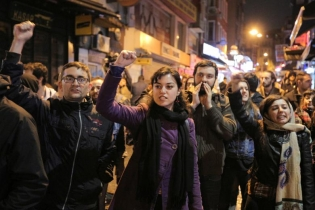 People protest against the results of the referendum in Istanbul.