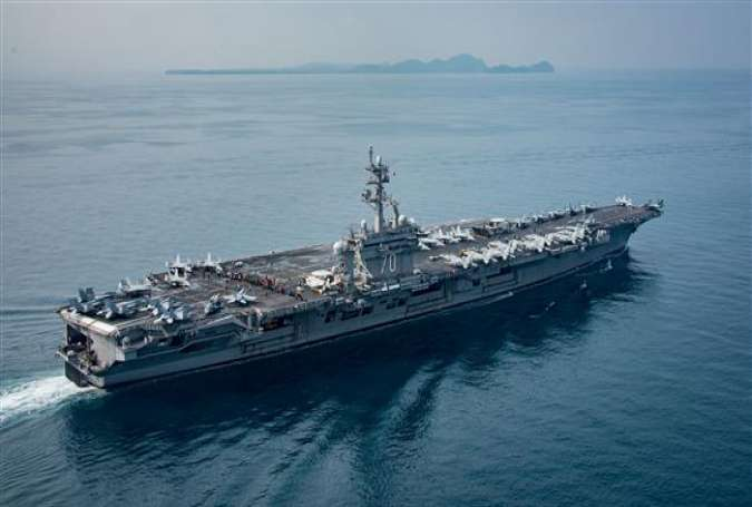 The aircraft carrier USS Carl Vinson transits the Sunda Strait between the Indonesian Islands of Java and Sumatra, April 15, 2017. The vessel was supposed to be further north in the Western Pacific at the time. (Photo via AFP)