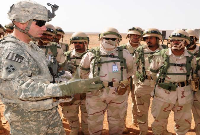 An American soldier talks with Saudi troops