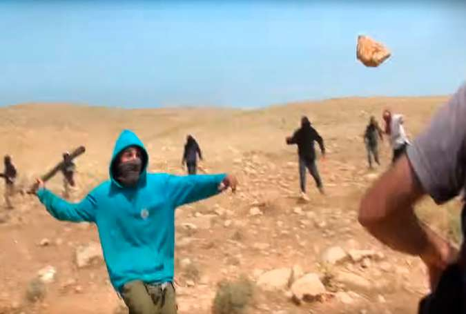 Masked Israeli settlers attack group of activists, Palestinian shepherds