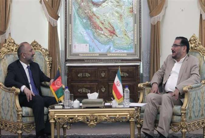 Undated picture shows Secretary of Iran's Supreme National Security Council Ali Shamkhani (R) meeting with Hanif Atmar, national security advisor to Afghan President Ashraf Ghani.