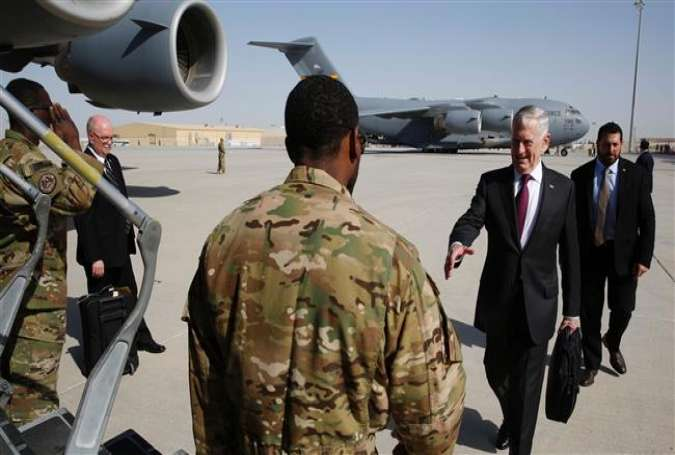 US Defense Secretary James Mattis prepares to shake hands with an airman prior to boarding a US Air Force C-17 plane en route to visit a US military base in Djibouti, in the Qatari capital Doha, April 23, 2017. (Photo by AFP)