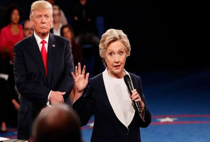 Democratic and Republican nominees for the US 2016 presidential election Hillary Clinton (R) and Donald Trump are seen during a debate.