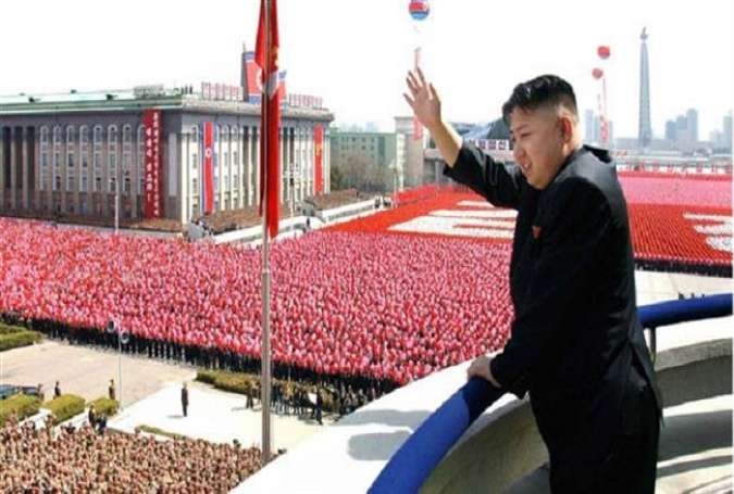 North Korean leader Kim Jong Un waves during a military parade in Pyongyang. (Photo by AP)