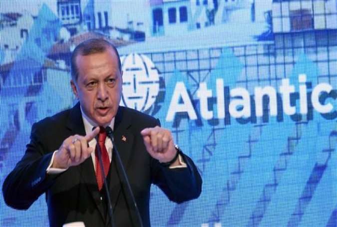 Turkish President Recep Tayyip Erdogan gestures as he gives a speech on April 28, 2017 during the Atlantic Council summit in Istanbul. (Photo by AFP)